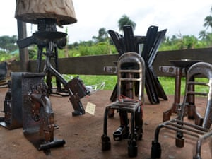 Items made from AK-47s, bazookas and various weaponry in a workshop on the outskirts of the Liberian capital Monrovia, where German blacksmith Manfred Zbrzezny and his apprentices refashion arms used in the country's civil wars into symbols of hope