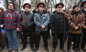 Pro-Russian Cossacks rally outside the Crimean parliament building on February 28, 2014 in Simferopol, Ukraine.