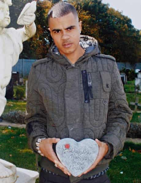 Mark Duggan, uncropped here to show him holding a memorial plaque for his stillborn child