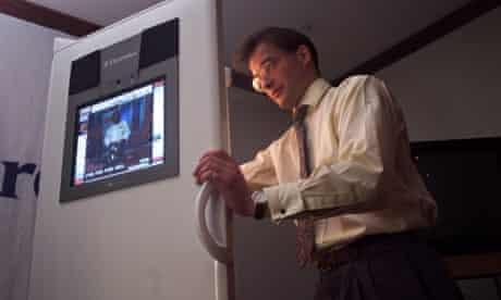 A man holding open the world's first touch-screen fridge