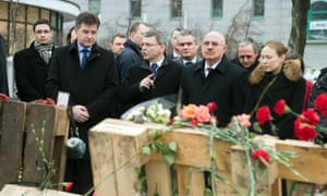 Foreign Ministers of the V4 countries Miroslav Lajcak (C-L to R) of Slovakia, Lubomir Zaoralek of the Czech Republic, Janos Martonyi of Hungary and Deputy Foreign Minister Katarzyna Pelczynska-Nalecz of Poland pay their tribute at a memorial for the protestors killed in clashes with the police in Independence Square in Kiev, Ukraine, 28 February 2014.