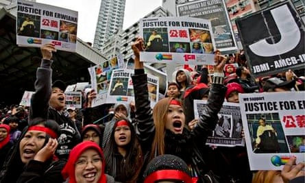 Domestic workers shout slogans during a protest in Hong Kong