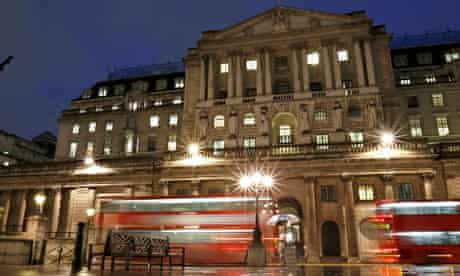 Busses pass the Bank of England in the city of London