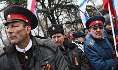 Pro-Russian Cossacks rally outside the Crimean parliament building in Simferopol, Ukraine