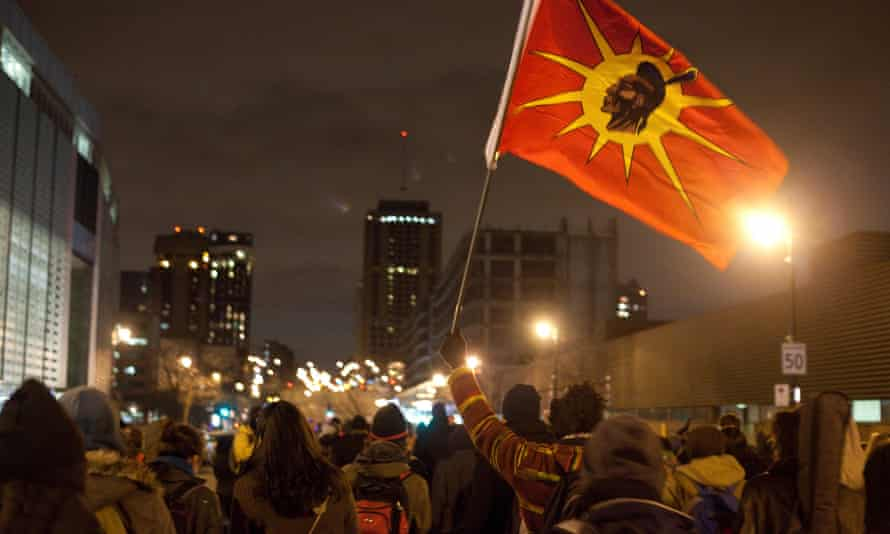 A man waves a Mohawk flag at a Montreal demonstration in support of the indigenous Idle No More movement in January, 2013.