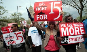 A group of workers and labor activists demanding a raise in the minimum wage for fast food workers in Detroit, Michigan.