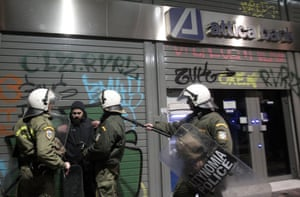 Anti-riot police detain a protester on February 1, 2014 in Athens, Greece, as antifascist organizations and left-wing political parties held a rally in protest at a rally organized by the far-right Golden Dawn party.