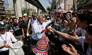 Protest leader Suthep Thaugsuban collects donations in Bangkok the day after the elections