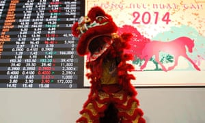 A lion dancer performs inside a trading floor at the Philippine Stocks Exchange (PSE) during Chinese Lunar New Year celebrations in Manila's Makati financial district February 3, 2014.