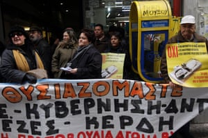 Demonstrators gather outside a tax office during a protest opposing auctions of homes by the state as a means of debt-management, in Athens, Greece, 03 February 2014.