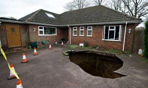 A view of the sinkhole on the driveway of the Conran's home in High Wycombe