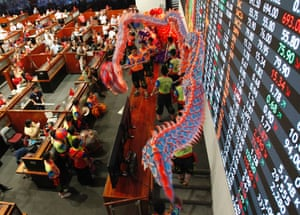 Dragon dancers perform inside a trading floor at the Philippine Stocks Exchange (PSE) during Chinese Lunar New Year celebrations in Manila's Makati financial district February 3, 2014.