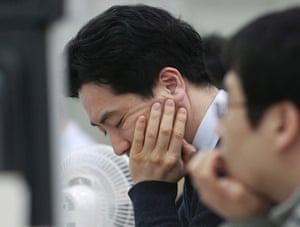 A currency trader reacts as he works at the Korea Exchange Bank headquarters in Seoul, South Korea, Tuesday, Feb. 4, 2014.