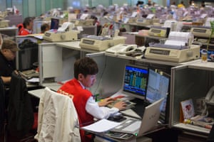 A stock trader monitors transactions during the first trading day of the Lunar New Year at the Hong Kong Exchanges and Clearings Limited in Hong Kong, China, 04 February 2014.