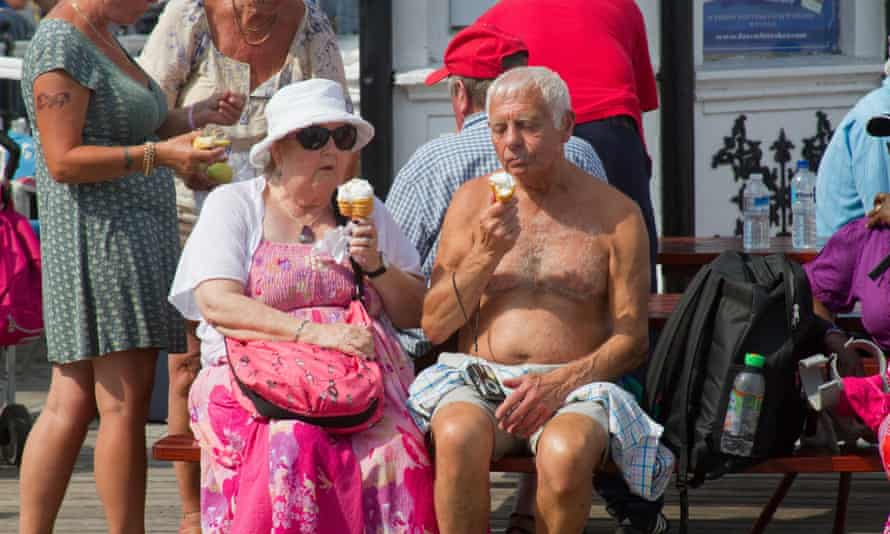 An elderly couple enjoy an ice cream on Brighton Pier in the summer heatwave of 2013. Heat-related deaths are expected to rise by 2050, as global warming causes temperatures to rise
