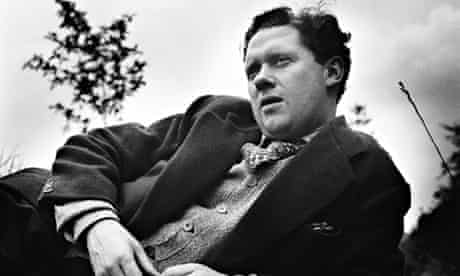 Dylan Thomas lying thoughtfully in a field, blade of grass in his hand