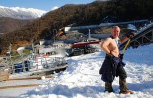 Blasnik, from Slovenia, takes a break while preparing the normal hill ski jump of the Russki Gorki venue