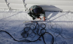 A technician prepares cables in the finish area of the Alpine skiing events