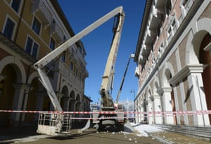 A crane stands outside a building during the ongoing construction in the media village
