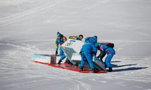 Volunteers prepare the podium in the finish area of the Alpine skiing events