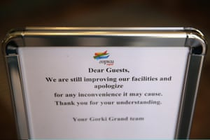 A sign apologises for delays to the opening of the Gorky Grand Hotel.