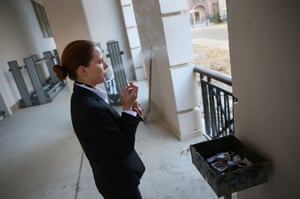 A receptionist from the Marriot hotel takes a break before the many guests are expected to arrive at Gorky Gorod 540.