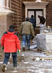 Workers outside the Gorky Gorod 960 hotel