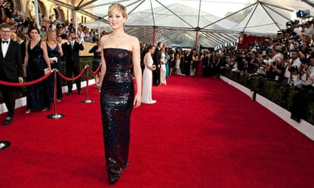 Jennifer Lawrence eyes up a fresh photobombing victim at the Screen Actors Guild awards.