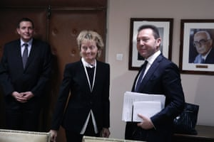 Greece's Finance Minister Yannis Stournaras, right, and his Swiss counterpart Eveline Widmer-Schlumpf arrive for a meeting in Athens on Tuesday, Feb. 4, 2014.