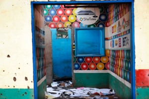 A Muslim owned satellite television shop stands looted in the Miskin district of Bangui, Central African Republic.