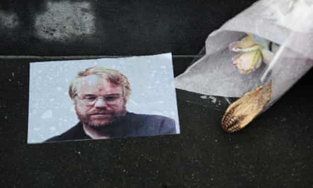 A makeshift memorial outside the apartment building where Philip Seymour Hoffman was found dead of an alleged drug overdose
