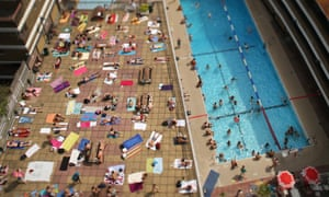 Swimmers enjoy the sunshine at an outdoor pool in central London in a heatwave in summer 2013