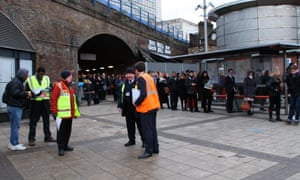 Commuters queue for buses outside Waterloo station