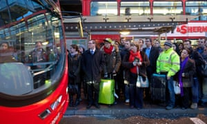 The buses were equally as busy as commuters queue outside Victoria Station