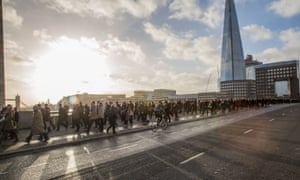 The last resort was to walk. Crowds of commuters make their way across London Bridge this morning.