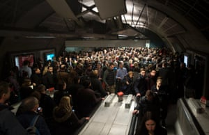 Commuters queue for access to the Jubilee line at Waterloo station.