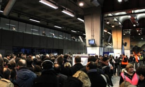 Commuters head to the trains after police give the go ahead for staff to open the barriers