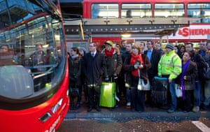Queues for buses at Victoria.