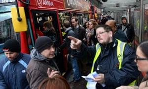 TFL staff redirect commuters at Victoria.