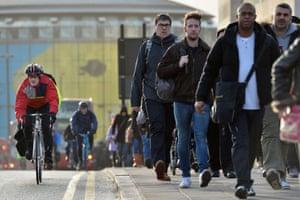 Pedestrians and cyclists cross Waterloo Bridge.