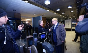 Mayor of London Boris Johnson (right) shakes hands with a London Underground worker during a visit to London Bridge station.