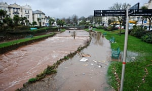 Debris sits in a swollen river in Dawlish, where high tides and strong winds have created havoc disrupting road and rail networks and causing damage to property.