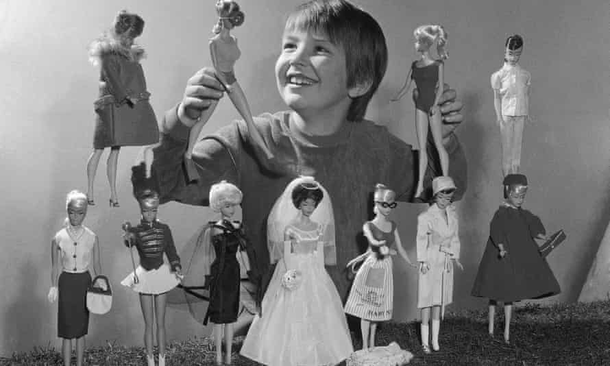 Misleading role models? … A young girl plays with Barbie dolls at the annual toy fair in Nurenberg, West Germany, in 1965.