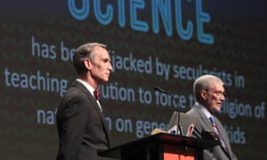 """Creation Museum head Ken Ham, right, speaks during a debate on evolution with TV's """"Science Guy"""" Bill Nye, at the Creation Museum Tuesday, Feb. 4, 2014, in Petersburg, Ky."""