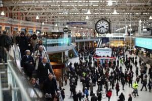 Commuters crowd Waterloo station.