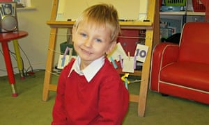Blond-haired Daniel Pelka pictured in a nusery or school in a red jumper