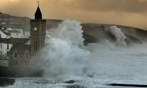 The sea rages as it thrashes the coast at Porthleven, Cornwall. Some of the largest waves in the world have smashed into the Westcountry coast today.