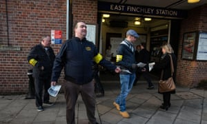 RMT members hand out leaflets explaining the reasons for the strike at East Finchley Station.