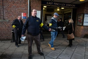 RMT union members hand out leaflets to the public explaining the reasons for the strike at East Finchley.
