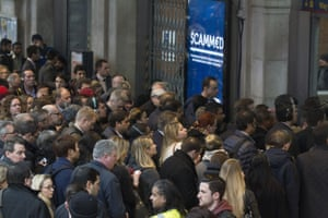 Crowds pour out of Waterloo station.